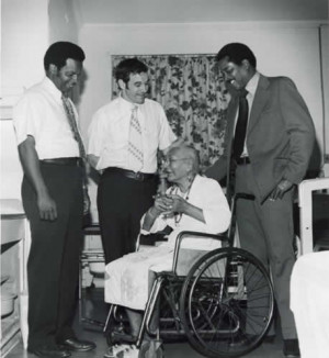 Here you see him laughing at a black woman in a wheel chair, one of ...