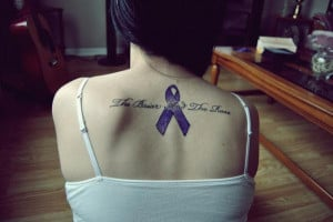 Blue ribbon and lettering memorial tattoo in memory of grandmother,
