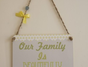 ... cute floral scalloped boarded plaque displaying a blended family quote