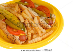 Chicago style hot dogs with french fries on yellow plate I - stock ...