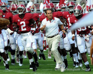 Alabama Coach Nick Saban leads his team to the field for the Florida ...