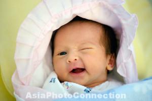 ; baby; infant; girl; winking; wink; smile; smiling; awake; eyes; eye ...