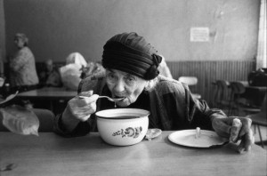 Old Woman at a Soup Kitchen