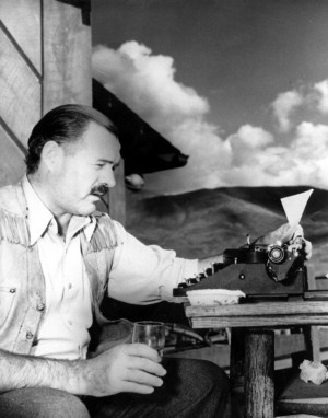 AP Nobel laureate Ernest Hemingway is shown at his typewriter while ...