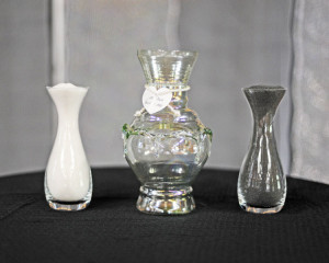 You can personalize both the sand pouring vases and central vase by ...