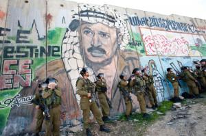 Yasser_Arafat_graffiti_West_Bank_wall_shutterstock.jpg