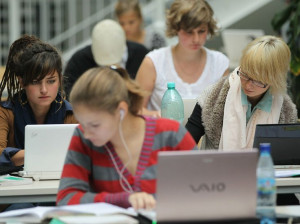 Students studying on their laptops in Berlin. Writer Clive Thompson ...