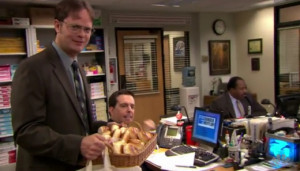 Bagels in hand, Dwight seeks to get his co-workers to