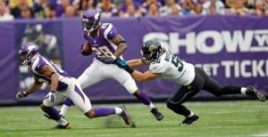 Minnesota Vikings running back Adrian Peterson (28) gains four yards ...