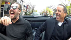 ... in the driver's seat ... Jerry Seinfeld, right, and Ricky Gervais