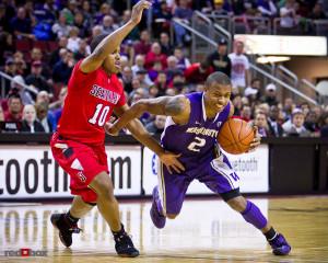 The University of Washington Huskies guard Isaiah Thomas drives to the ...