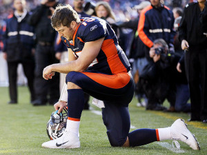 Tim Tebow scores his own theme song, plus more from Brad Pitt, Madonna ...