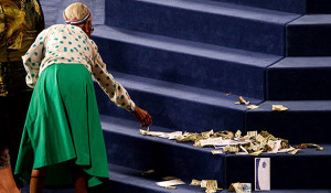 Old-woman-giving-cash-in-church-Preachers-of-LA-False-Prophets-Exposed ...