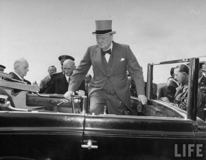 Churchill in car with top hat