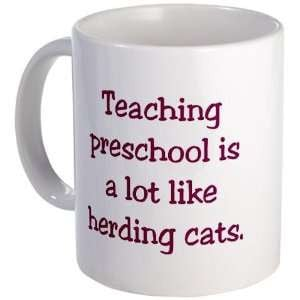 is a lot like herding cats Funny Mug by CafePress: Kitchen & Dining