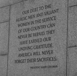 """... World War II Memorial, reading """"Our debt to the heroic men and"""
