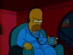 Homer listening to The Good Book [The Bible] read by Larry King