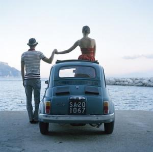 Love in car at seashore