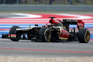Heikki Kovalainen gets the power down in his Lotus