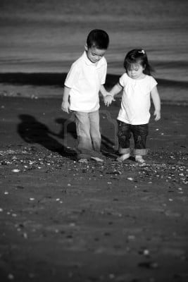 7090762-brother-and-sister-walking-hand-in-hand-at-the-beach.jpg