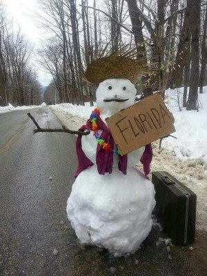 ... the Snowmn holding a Florida sign with suitcase. Too much snow 2013