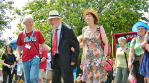 ... procession in 2013, flanked by Nigel Costley and Frances O'Grady