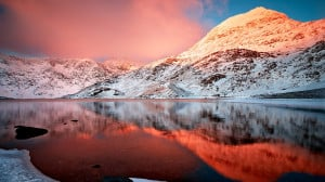 Winter lake snow capped mountains the red glow beauty Wallpaper.jpg
