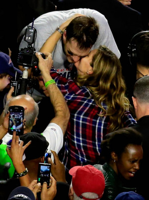 Tom Brady #12 of the New England Patriots kisses his wife Gisele ...