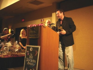 Clive Barker accepts his trophy for Abarat: Days of Magic, Nights of