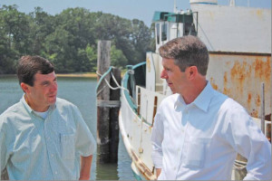 Tommy Kellum left speaks with Rep Rob Wittman R Montross during