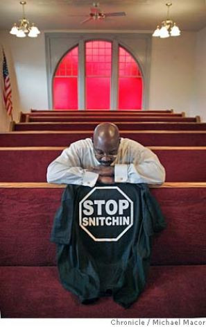 OAKLAND / T-shirts illustrate divide / 'Stop snitchin' stymies police ...