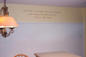 wall quotation above the table and chair with a chandelier on the ...