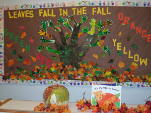 ... painted leaves and arm and hand print branches made up our fall tree