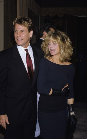 Ryan O'Neal and Farrah Fawcett circa 1980s