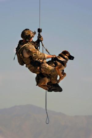 Airman 1st Class Jason Fischman hoists a U.S. Army tactical explosive ...