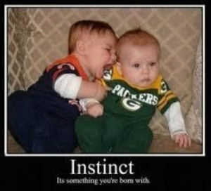 Here's a Bears Baby Biting a Packers Baby