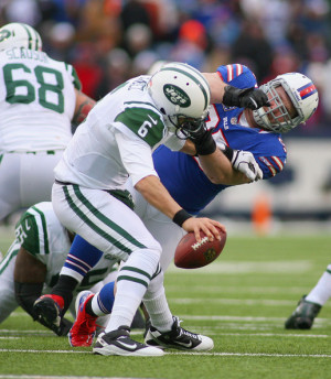 95 of the Buffalo Bills pressures Mark Sanchez #6 of the New York Jets ...