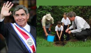 Costa Rican President Oscar Arias shoveled dirt onto the roots of an ...