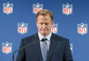 NFL Commissioner Roger Goodell pauses as he speaks during a news ...