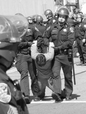 Anti-war activist arrested in San Francisco during the March 2003 ...