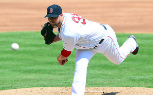 Jon Lester and the Red Sox have put extension talks on hold. (USATSI)