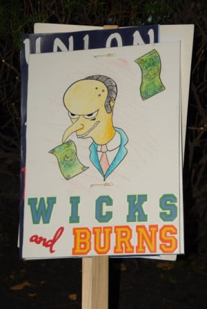 An OEA employee protest sign: OEA Exec. Director Larry Wicks was paid ...