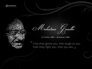 Motivational Wallpaper Quote by Mahatma Gandhi: First they ignore you ...