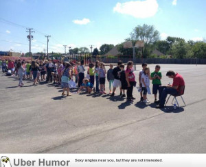 Elementary school students line up for a yearbook signature from the ...