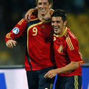 Fernando Torres of Spain celebrates with team-mate David Villa