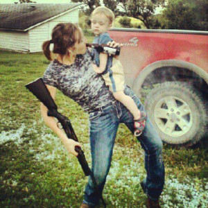 REAL Mom's can drink, shoot, and hold their kids