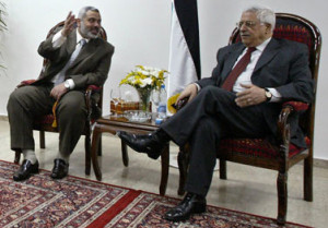 Palestinian President Mahmoud Abbas, right, meets with Palestinian ...
