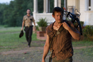 Background) Rick Grimes (Andrew Lincoln) and (Forground) Daryl Dixon ...