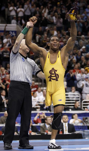 ... to claim the 125-pound NCAA Division I individual wrestling title