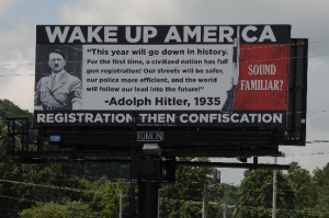 billboard that uses Adolph Hitler to warn of the dangers of gun ...